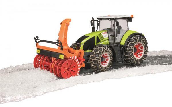 Claas Axion Traktor mit Schneeketten und Fräse
